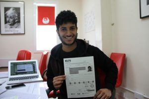 Young Man Showing his Ielts-Certificate