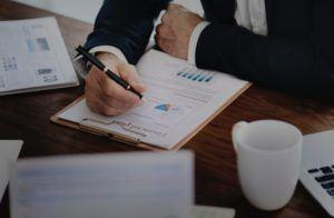 Businessman Studying an Economic Chart
