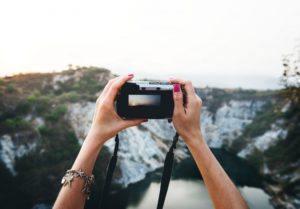 Photographer Holding a Digital Camera