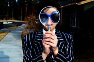 Man Looking into a Magnifying Glass
