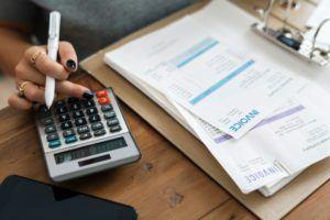Calculator, Pen, Invoice and Paperwork