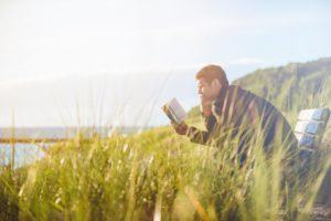 Man Reading in a Meadow About Possible Arguments Against Moral Relativism