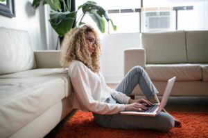 Woman Using Laptop While Answering the Question What Is an Internet Affiliate Marketing Program