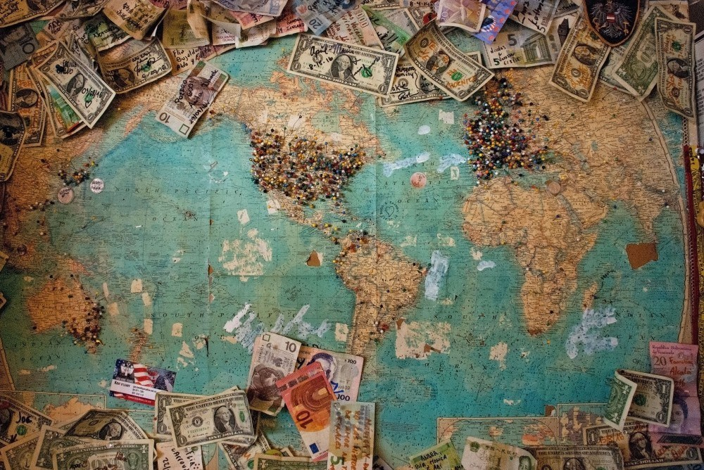 Earth Map Surrounded by Currencies