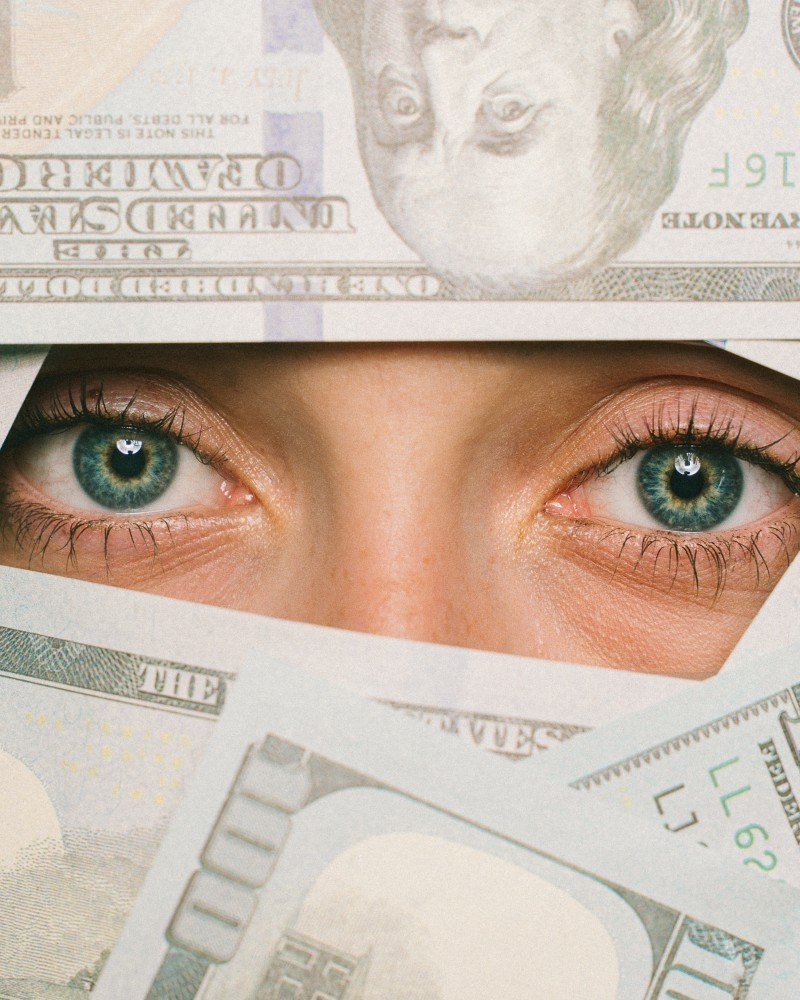 Human Face Surrounded by Bills
