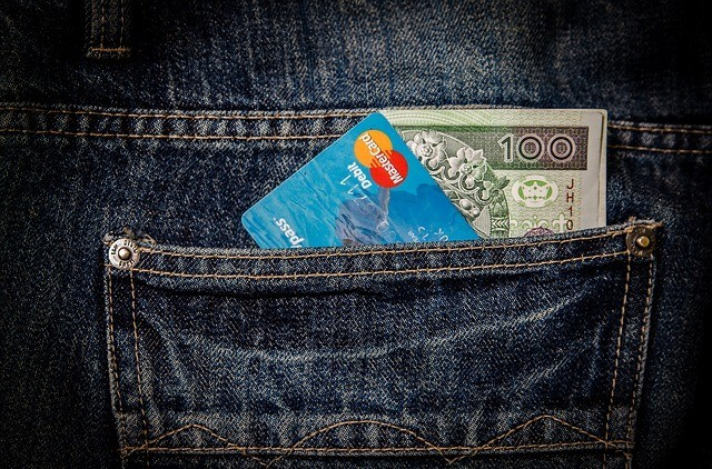 Credit Card and Money in a Pocket For Short-Term Financial Goals