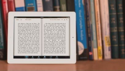 Learn Hebrew, the Language of the Bible: Ebook reader in Front of a Bookcase