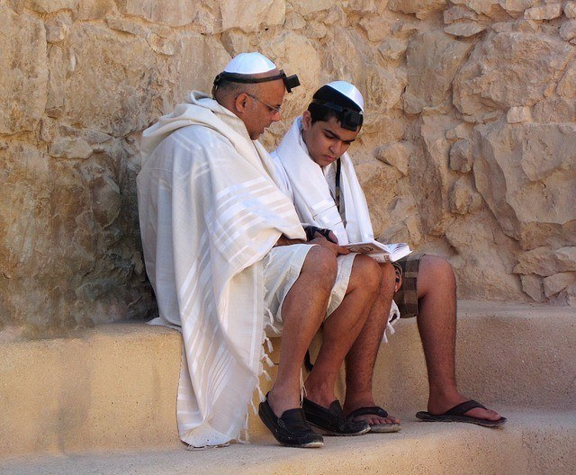 Bar Mitzvah vs. Bat Mitzvah: Father Teaching His Son